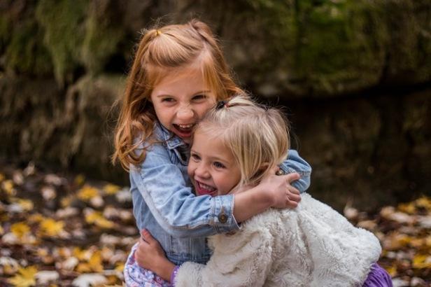 2 girls hugging autumn, volunteering with children