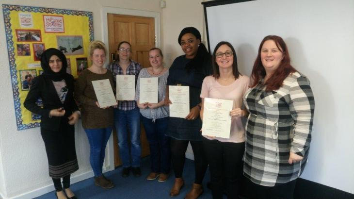 Group of volunteers with training certificates